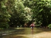 Anne-Marie crossing the river in the rainforest